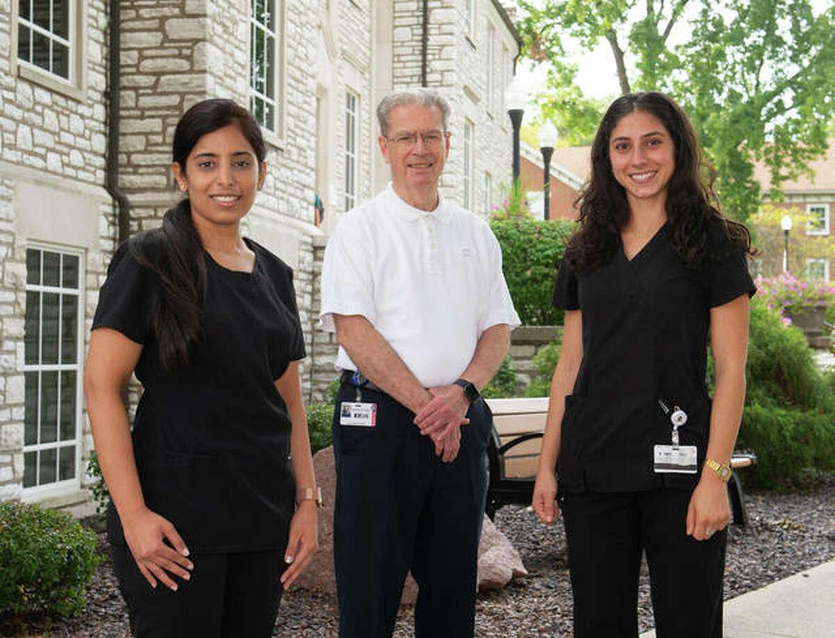 SIU SDM endodontics post graduate program director Marvin Leigh Speer, DDS, MS, FACD stands in center with program residents Priya Sapra Kullar (left) and Tara Habibi (right).
