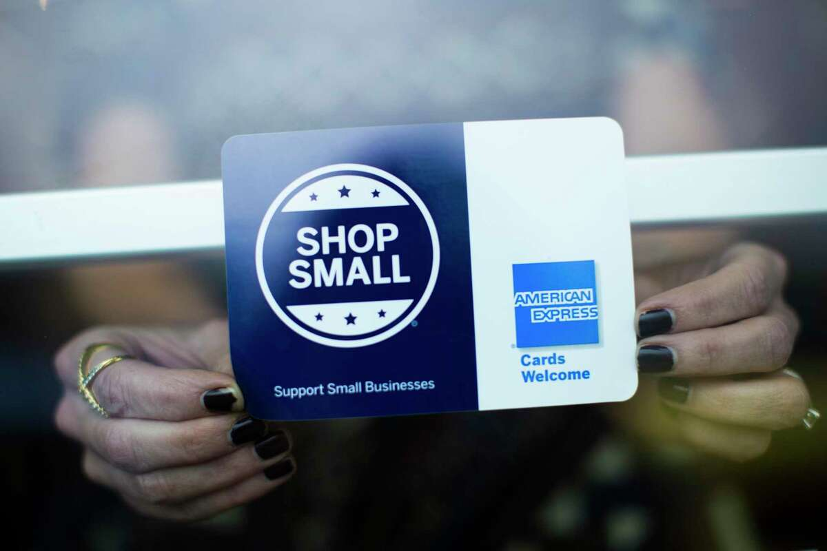 Kairy-tate Barkley places a sign with the logo of Small Business Saturday which is a recent tradition to shop in small businesses the day after Black Friday. Barkley is the owner of French Cuff Boutique which will participate in the Small Business Saturday. Monday, Nov. 16, 2015, in Houston. ( Marie D. De Jesus / Houston Chronicle )