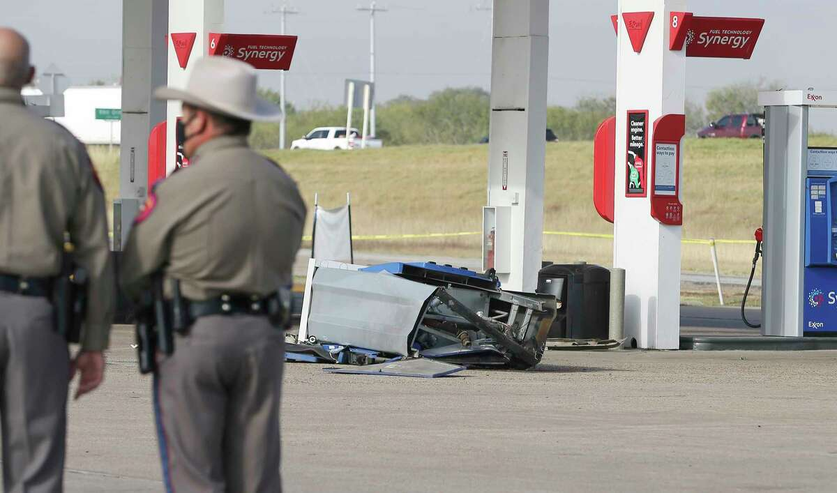 A fuel pump is crumpled to the ground after a vehicle carrying several undocumented immigrants crashes into it after a chase by Department of Public Safety Troopers at the Texas Best Exxon at I-35 South and 1604 on Thursday, Nov. 19, 2020. The chase started around 8 a.m. when Frio County law enforcement noticed a truck carrying several males and suspected possible human trafficking. A chase ensued heading north on I-35 and DPS troopers were asked to intervene. The truck made it to a gas station with troopers pursuing it when it struck a gas pump. The driver, a male U.S. citizen was detained and taken to an area hospital with unknown injuries. Seven adult males - all undocumented - were also detained at the scene and U.S. Customs and Border Protection agents were called to process the undocumented individuals at the scene. The 26-year-old driver is charged with evading arrest, aggravated assault and human smuggling according to State Trooper Sgt. Orlando Moreno.