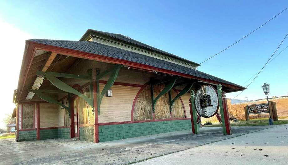 In this Nov. 19, 2020 file photo, the old railroad depot sits, closed and boarded up, on Maple Street in Big Rapids. (Pioneer file photo)