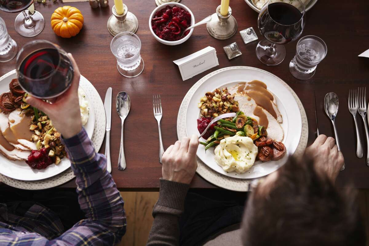 The CDC is reminding Americans that 6 feet apart applies to Thanksgiving dinner too.