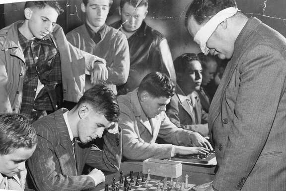 Chess master George Koltanowski had a chess puzzle in the Chronicle for many years. Here he plays several opponents blindfolded December 1948  Photo ran 12/12/1948, p. 32