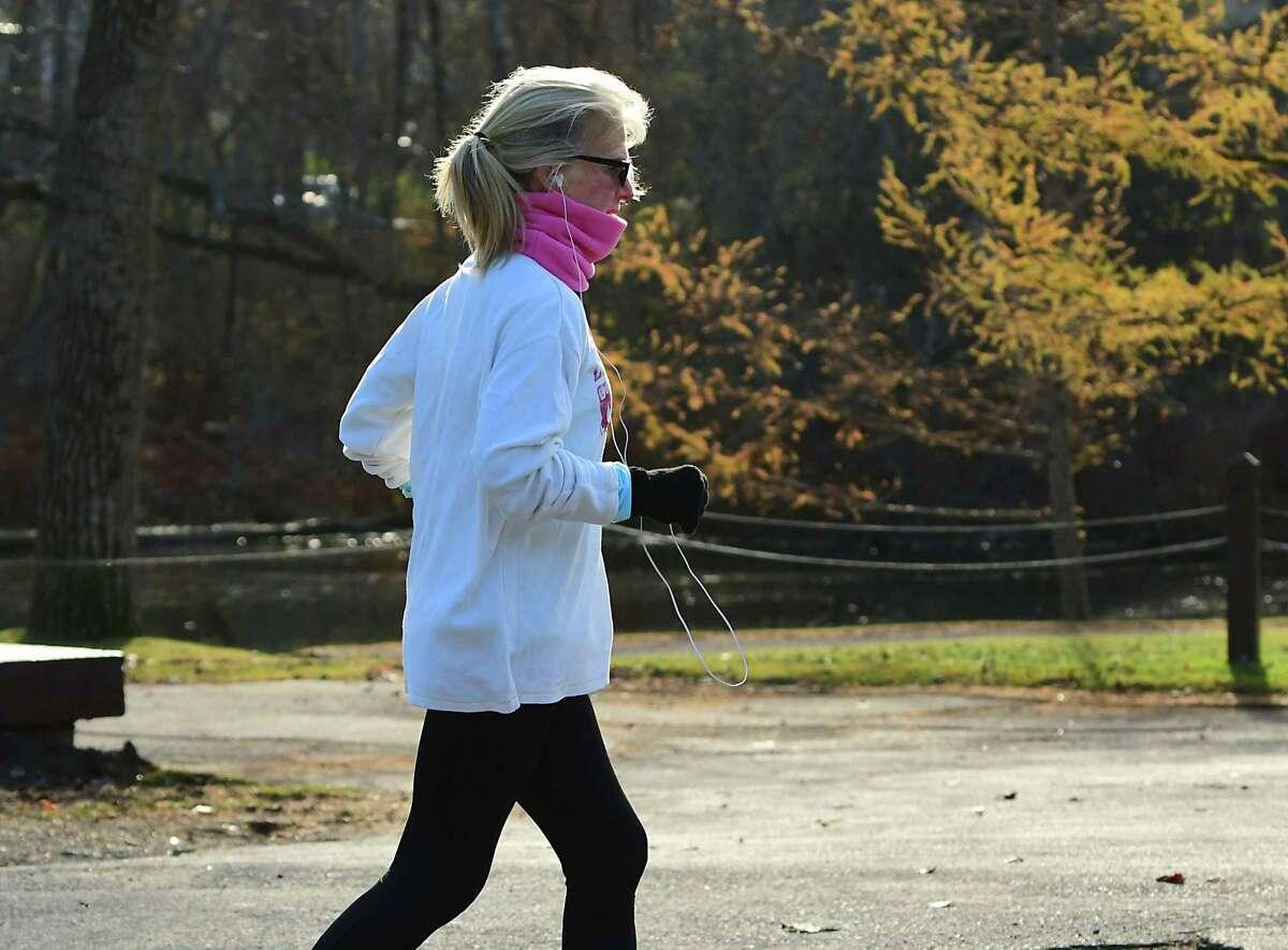 A woman is seen jogging near Buckingham Pond on Thursday, Nov. 19, 2020 in Albany, N.Y. (Lori Van Buren/Times Union)