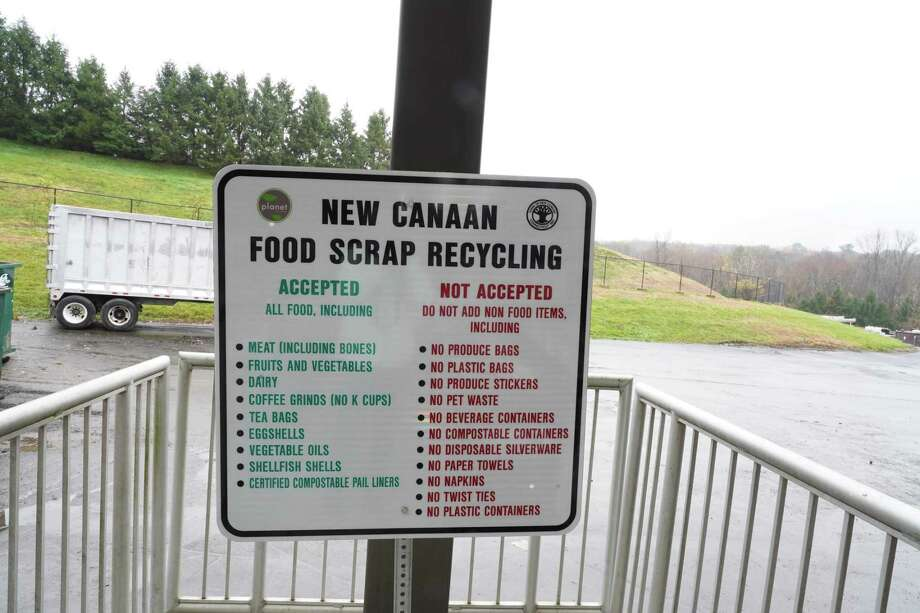 The New Canaan Transfer Station is accepting food scraps for recycling. Bins for the food scraps can be found next to a sign that describes what is accepted and what is not. Photo: Grace Duffield / Hearst Connecticut Media