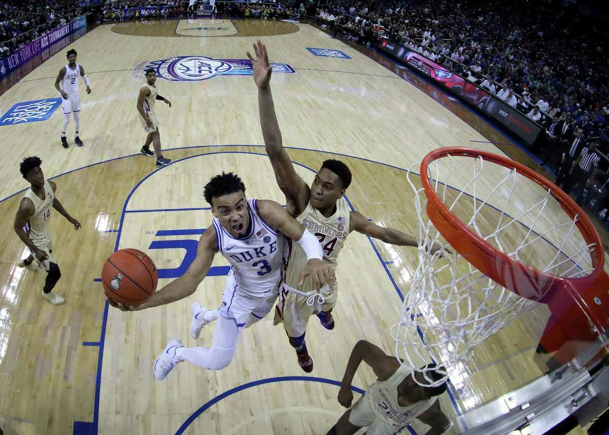 CHARLOTTE, NORTH CAROLINA - MARCH 16: Tre Jones #3 of the Duke Blue Devils drives to the basket against Devin Vassell #24 of the Florida State Seminoles during the championship game of the 2019 Men's ACC Basketball Tournament at Spectrum Center on March 16, 2019 in Charlotte, North Carolina. (Photo by Streeter Lecka/Getty Images)