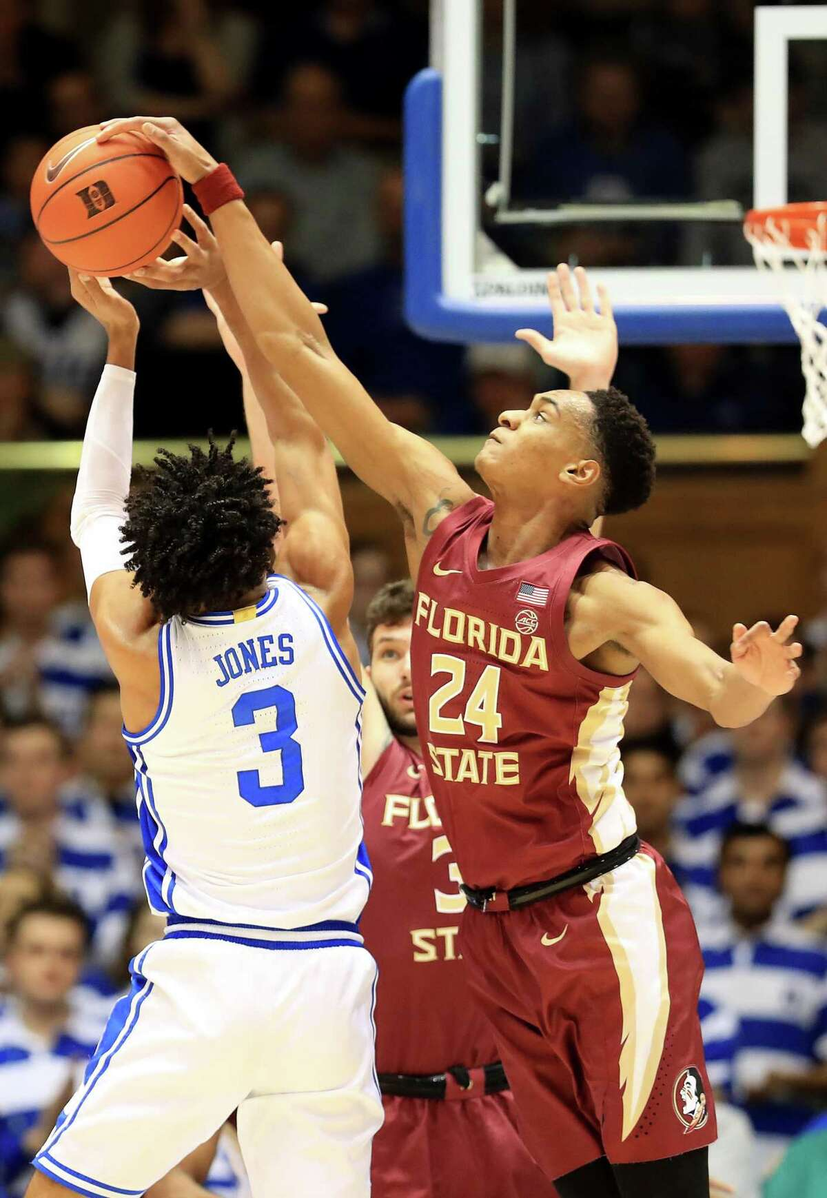 The Spurs drafted Florida State's Devin Vassell, right, with the 11th overall pick. Vassell, a 6-foot-7 guard, was regarded as one of the draft's top wing defenders.