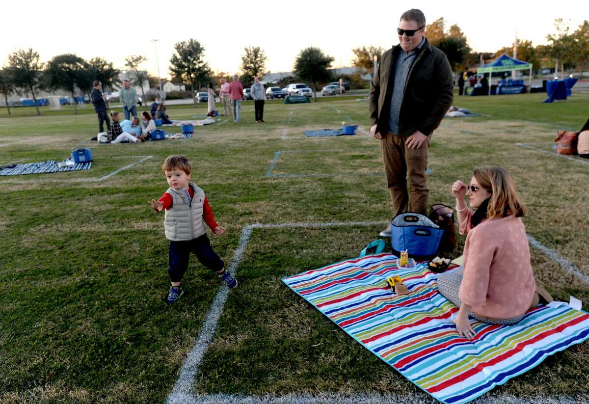 Families and friends gather during a sociallly distanced picnic on the Great Lawn at the Event Centre to introduce Beaumont Convention and Visitors Bureau's new Geocaching program to help prromote local attractions in the time of COVID-19. Photo taken Wednesday, November 18, 2020 Kim Brent/The Enterprise