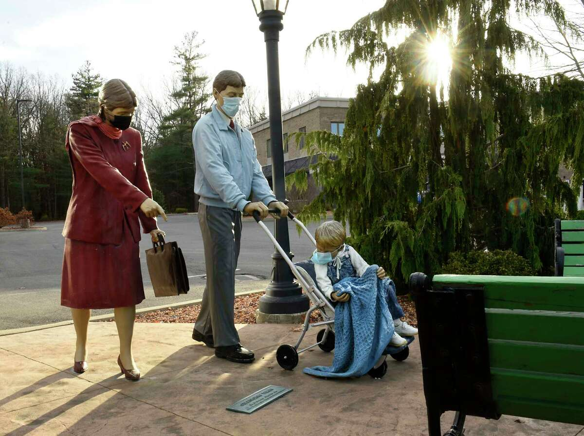 """A sculpture titled """"Changing Times"""" by Seward Johnson Jr. is seen in the Town Plaza on Thursday, Nov. 19, 2020 in Clifton Park, N.Y. (Lori Van Buren/Times Union)"""