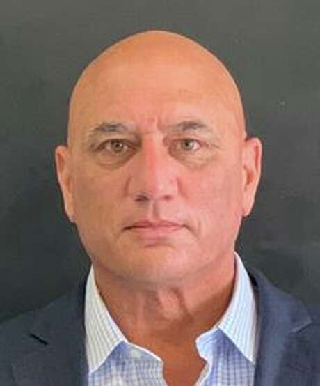 Emmet Hibson, the former Human Resources Director for the Town of Fairfield, was arrested by Fairfield Police and charged with illegal disposal of PCB's, and conspiracy to commit illegal disposal of PCB's. Photo: Fairfield Police Department / Contributed Photo / Fairfield Citizen