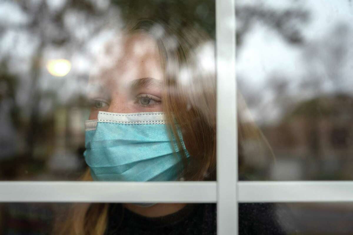 Lilly Stecklein looks out the window of her home in Prairie Village, Kan., on Nov. 10, 2020.