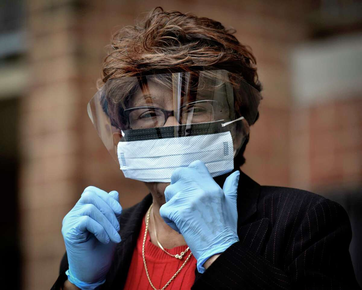 Easter Brown, photographed in Washington in August 2020, is living with no teeth because the pandemic shut down her dentist's work before he could provide the 77-year-old with dentures.