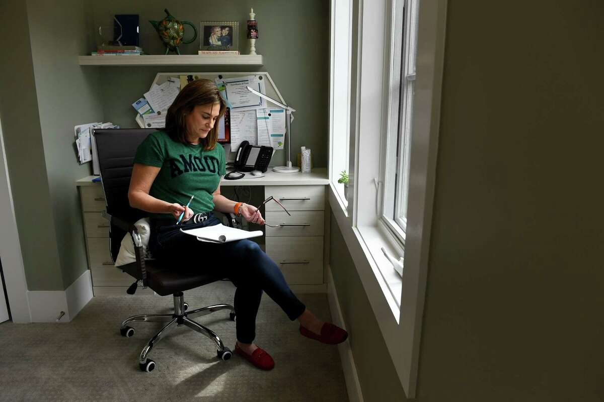 Sue-Ann Siegel goes over notes in March 2020 as she monitors the Montgomery County, Md., Hotline from her home office.