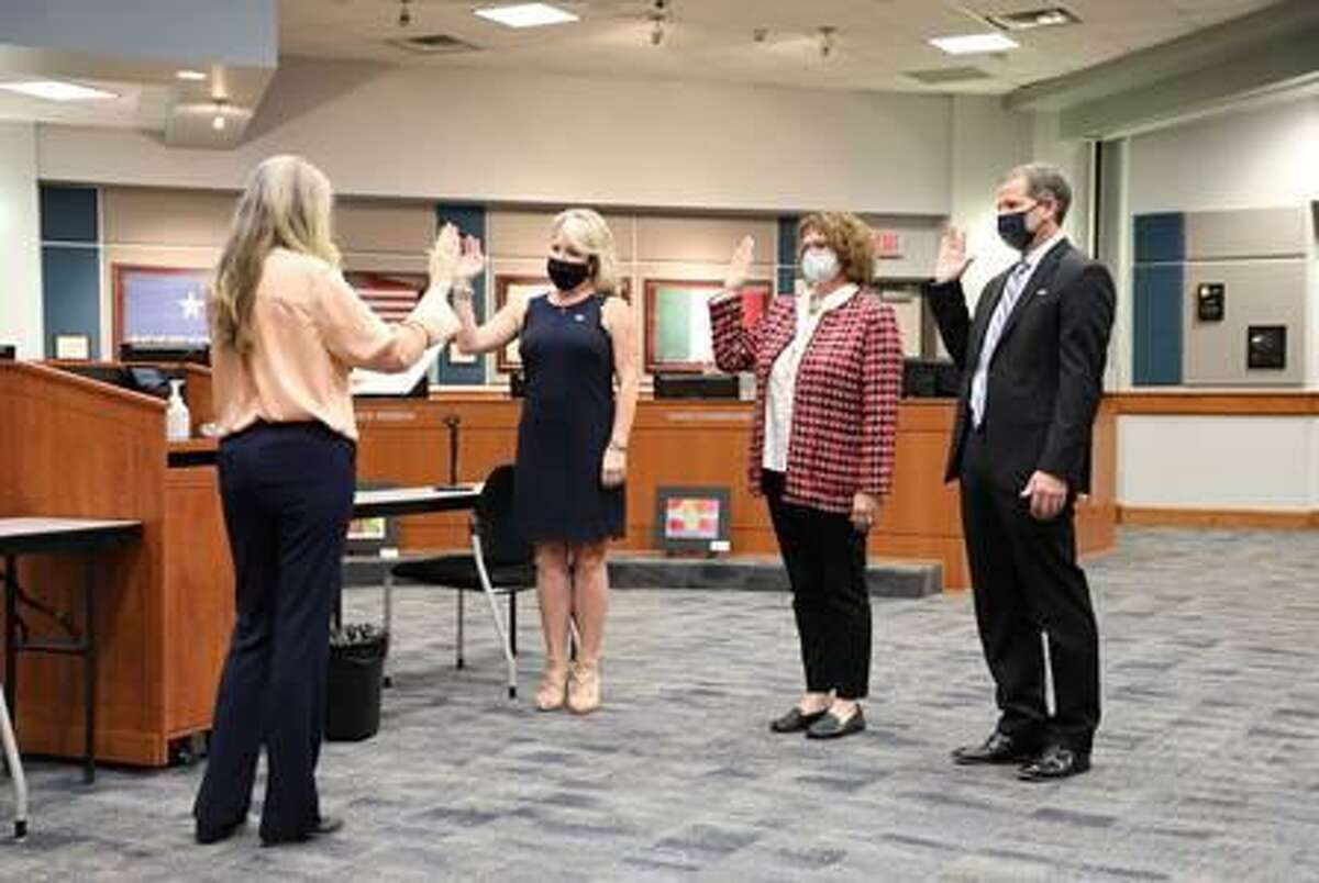 Ashley Vann, from second from left, Leah Wilson and Greg Schulte are sworn in to serve on the Katy Independent School District Board of Trustees on Wednesday, Nov. 18.