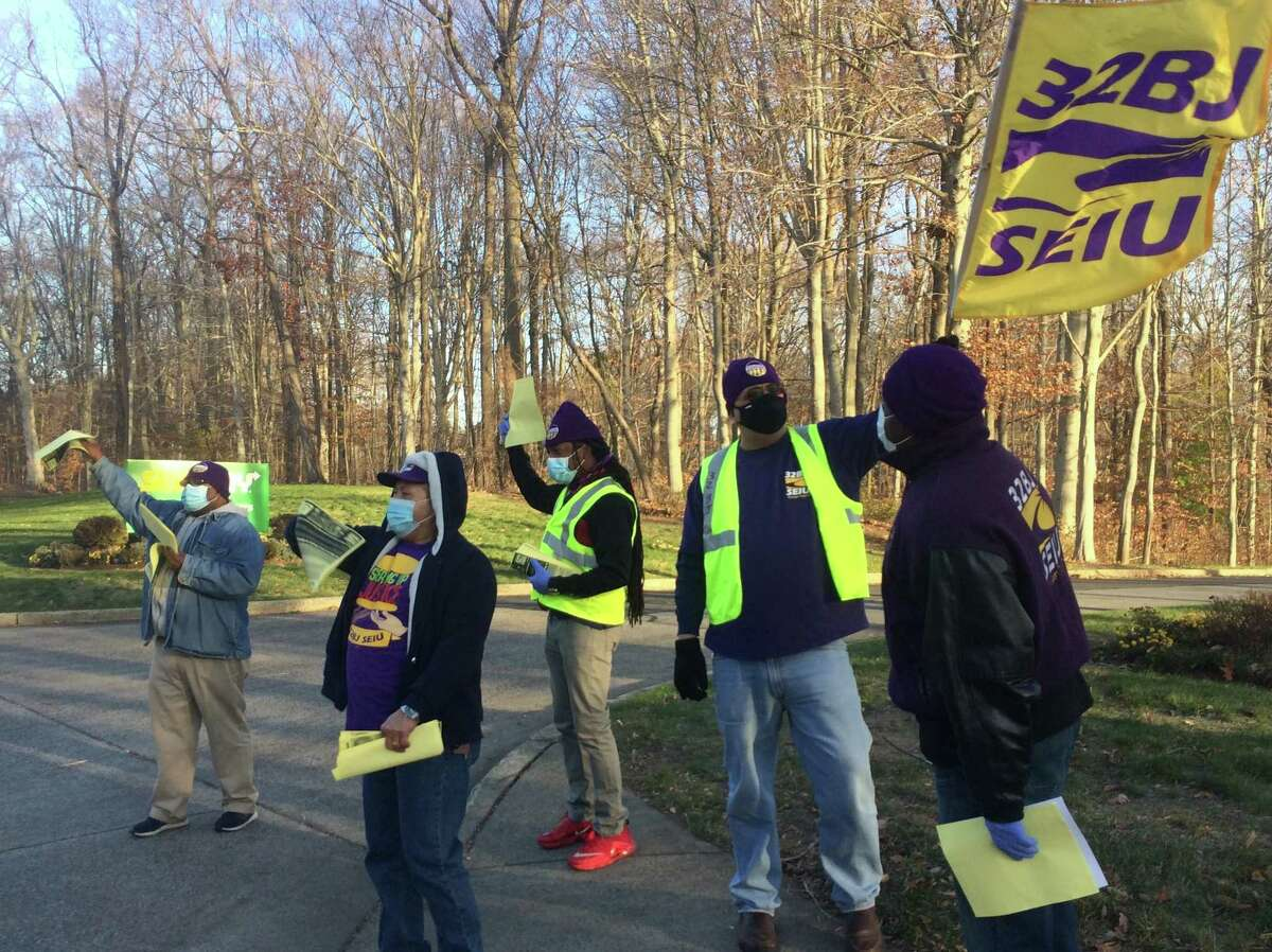 Members of the Service Employees International Union Local 32BJ rally in front of Subway headquarters in Milford on Thursday.