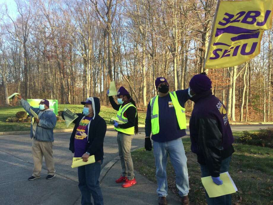 Members of the Service Employees International Union Local 32BJ rally in front of Subway headquarters in Milford on Thursday. Photo: Donald Eng / Hearst Connecticut Media