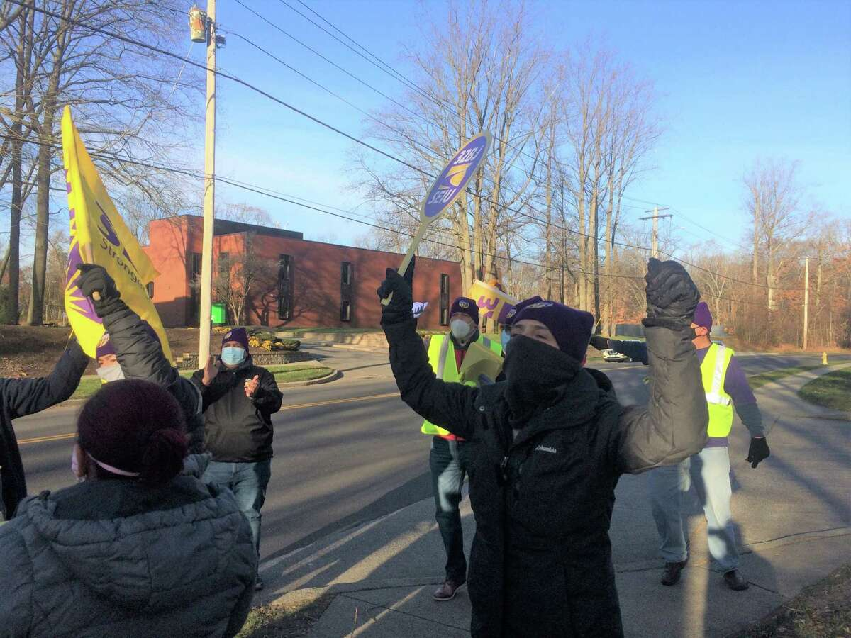 Members of the Service Employees International Union Local 32BJ rally in front of Subway headquarters in Milford on Thursday. The union is seeking an end to what it calls unfair labor practices by the company's Interstate 95 rest area franchisees.