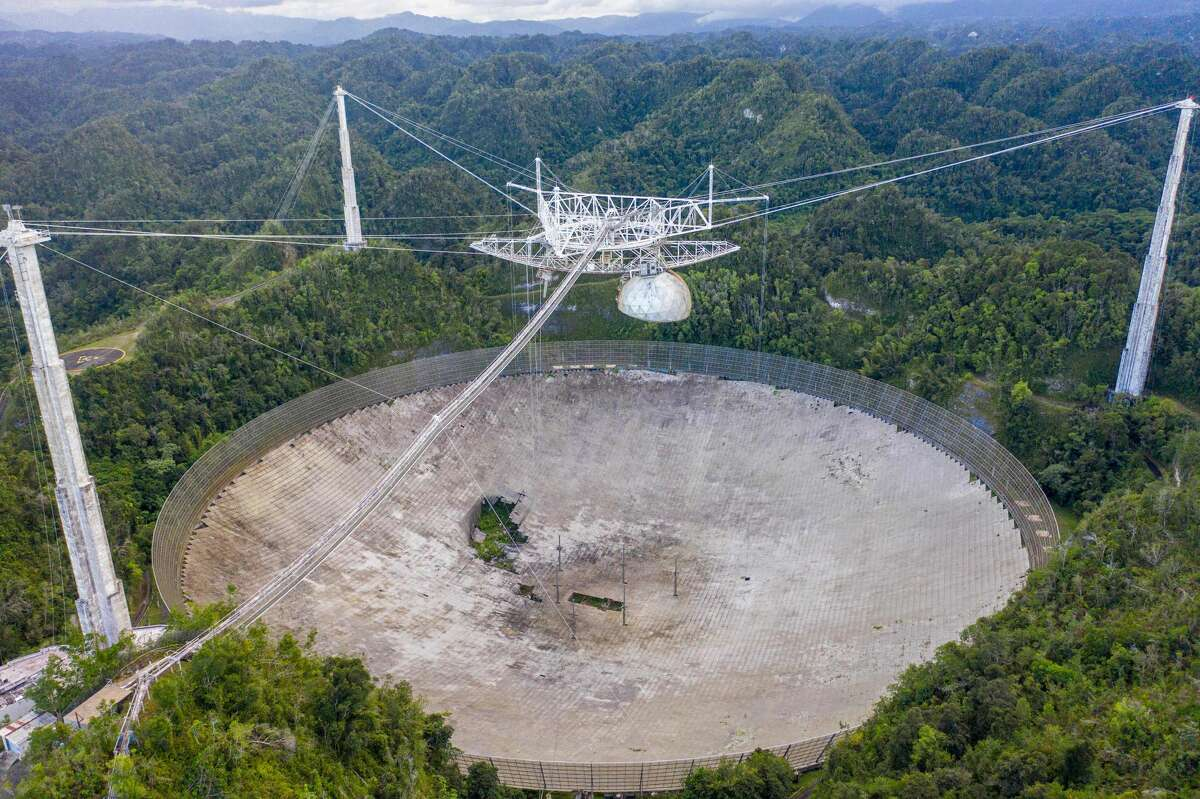 This aerial view shows a hole in the dish panels of the Arecibo Observatory in Arecibo, Puerto Rico, on November 19, 2020. The National Science Foundation (NSF) announced on November 19, 2020, that it will decommission the radio telescope.