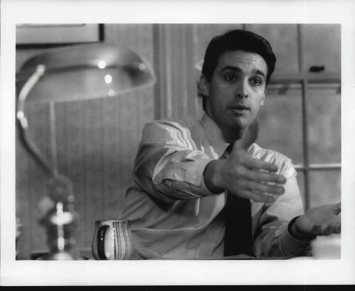 Troy, New York - Patrick McKenna, a Concord Coalition member, speaks about the National Debt in his Troy home. December 8, 1993 (Steve Jacobs/Times Union Archive)