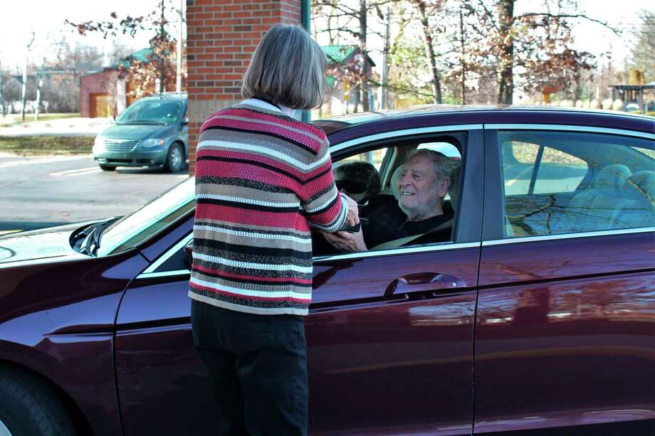 Nancy Kawiecki, center services manager, hands out meals at Senior Services Thanksgiving curbside meal event on Wednesday, Nov. 18, 2020. (Photo provided/Senior Services)