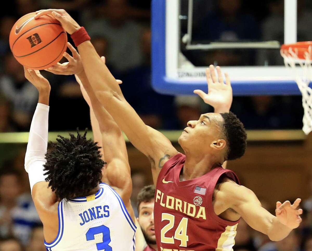 DURHAM, NORTH CAROLINA - FEBRUARY 10: Devin Vassell #24 of the Florida State Seminoles tries to stop Tre Jones #3 of the Duke Blue Devils during their game at Cameron Indoor Stadium on February 10, 2020 in Durham, North Carolina. (Photo by Streeter Lecka/Getty Images)