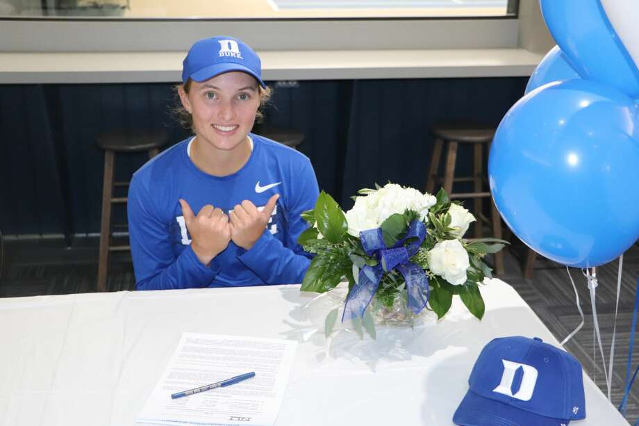 Midland's Ellie Coleman poses with her National Letter of Intent after signing Tuesday to attend and play tennis at Duke University Photo: Photo Provided