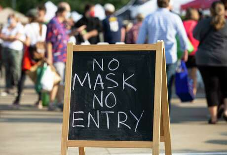 People visiting the Urban Harvest Farmers Market, which requires wearing masks for entry, Saturday, Oct. 3, 2020, in Houston.