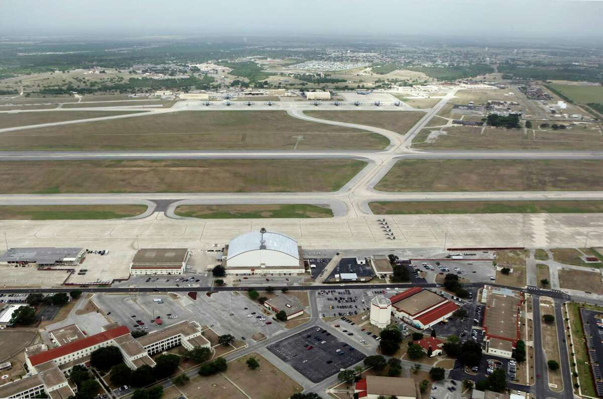 The former Kelly Air Force Base, in the foreground is seen in this July 1, 2011 aerial picture. In the background is Lackland Air Force Base and the 433rd Air Lift Wing. (William Luther/wluther@express-news.net)