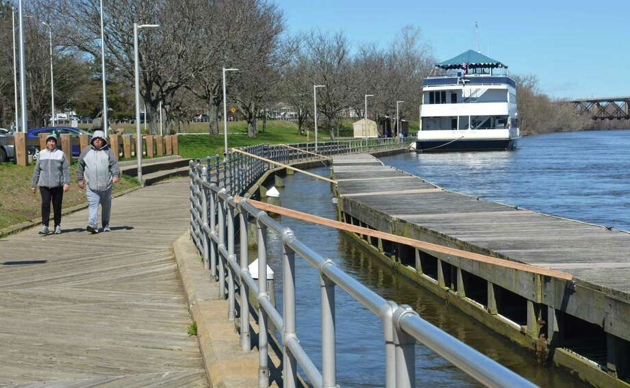 Middletown's next 10-year plan of conservation and development will address a number of issues, such as access to the Connecticut River. Last April, a couple made its way along the boardwalk at Harbor Park. Photo: Hearst Connecticut Media File Photo