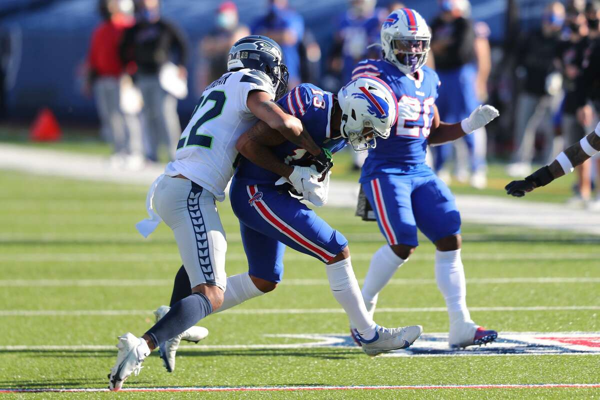 ORCHARD PARK, NEW YORK - NOVEMBER 08: Quinton Dunbar #22 of the Seattle Seahawks tackles Gabriel Davis #13 of the Buffalo Bills during the first half at Bills Stadium on November 08, 2020 in Orchard Park, New York. (Photo by Timothy T Ludwig/Getty Images)