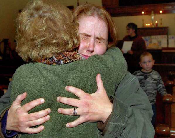 Jocelyn McDonald, center, receives a supportive hug following a candlelight vigil held in behalf of her son Jaliek Rainwalker, 12, on Friday, Nov. 9, 2007, at the Salem United Methodist Church in Salem, N.Y. Jaliek was last seen Nov. 1. (Cindy Schultz / Times Union) Photo: CINDY SCHULTZ / ALBANY TIMES UNION