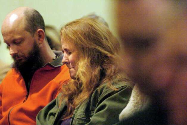Jocelyn McDonald, center, and her husband Stephen Kerr, left, attend a candlelight vigil held in behalf of their son Jaliek Rainwalker, 12, on Friday, Nov. 9, 2007, at the Salem United Methodist Church in Salem, N.Y. Jaliek was last seen Nov. 1. (Cindy Schultz / Times Union) Photo: CINDY SCHULTZ / ALBANY TIMES UNION