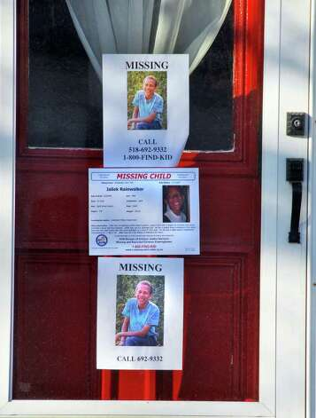Missing posters on front door of home at 11 Hill Street in Greenwich Tuesday afternoon November 13, 2007, for missing 12-year-old Jaliek Rainwalker. (John Carl D'Annibale / Times Union) Photo: John Carl D'Annibale / Albany Times Union