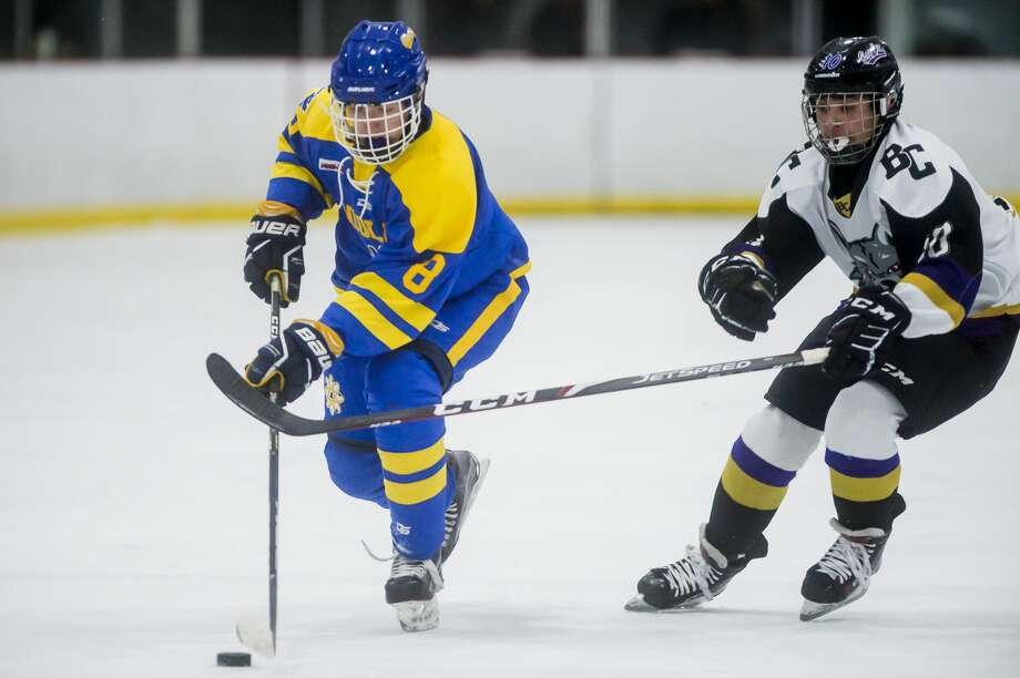 Midland High's Tanner Squires brings the puck up the ice during a Feb. 26, 2020 game against Bay City. Photo: Daily News File Photo
