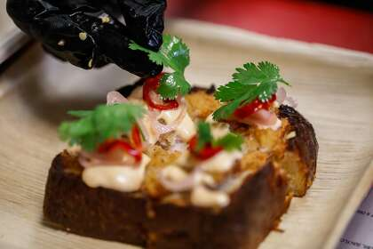 Chef Intu-On Kornnawong prepares the Kanom Pung Nha Koong (shrimp mousse toast) for Intu-On, a Thai food pop-up at a Birba wine bar in Hayes Valley on Sunday, Nov. 15, 2020 in San Francisco, California.