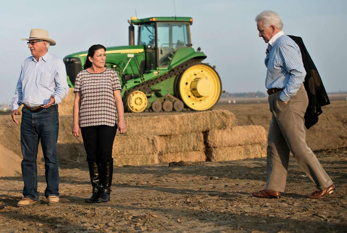 Rep. Jim Costa, D-Fresno (right), meets with Joe and Maria Gloria Del Bosque on their farm in 2014. Costa is seeking to become the chairman of the powerful House Agriculture Committee.