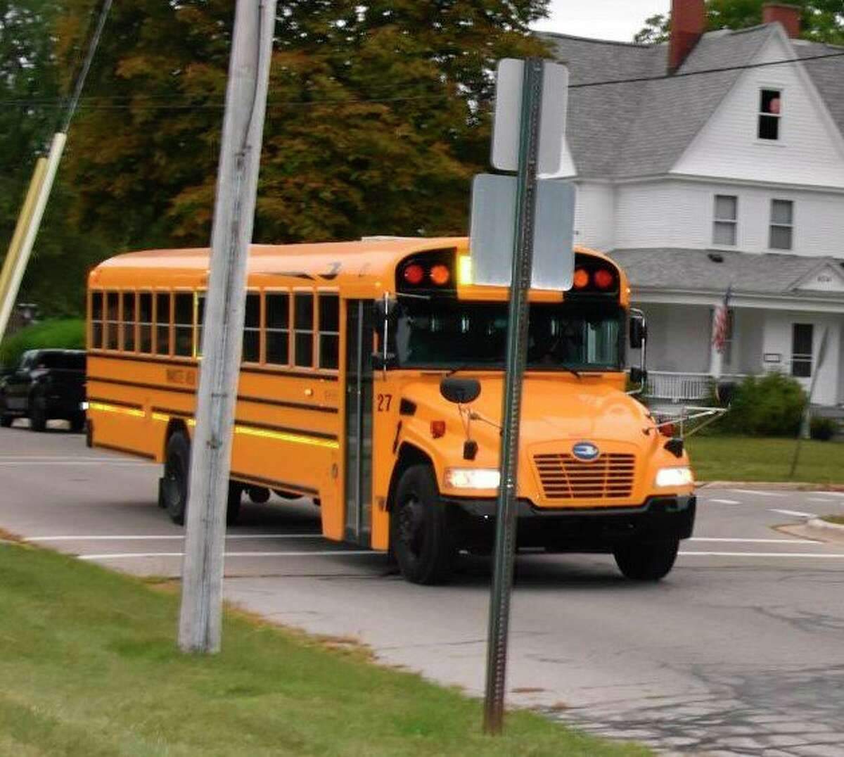 A school bus reaches Jefferson Elementary School on Sept. 8. All buildings in the Manistee Area Public Schools district were closed Thursday after a bus driver tested positive for COVID-19. Students will learn remotely on Friday and the board of education will hold an emergency meeting on Nov. 20 to determine the district's next course of action. (File photo)