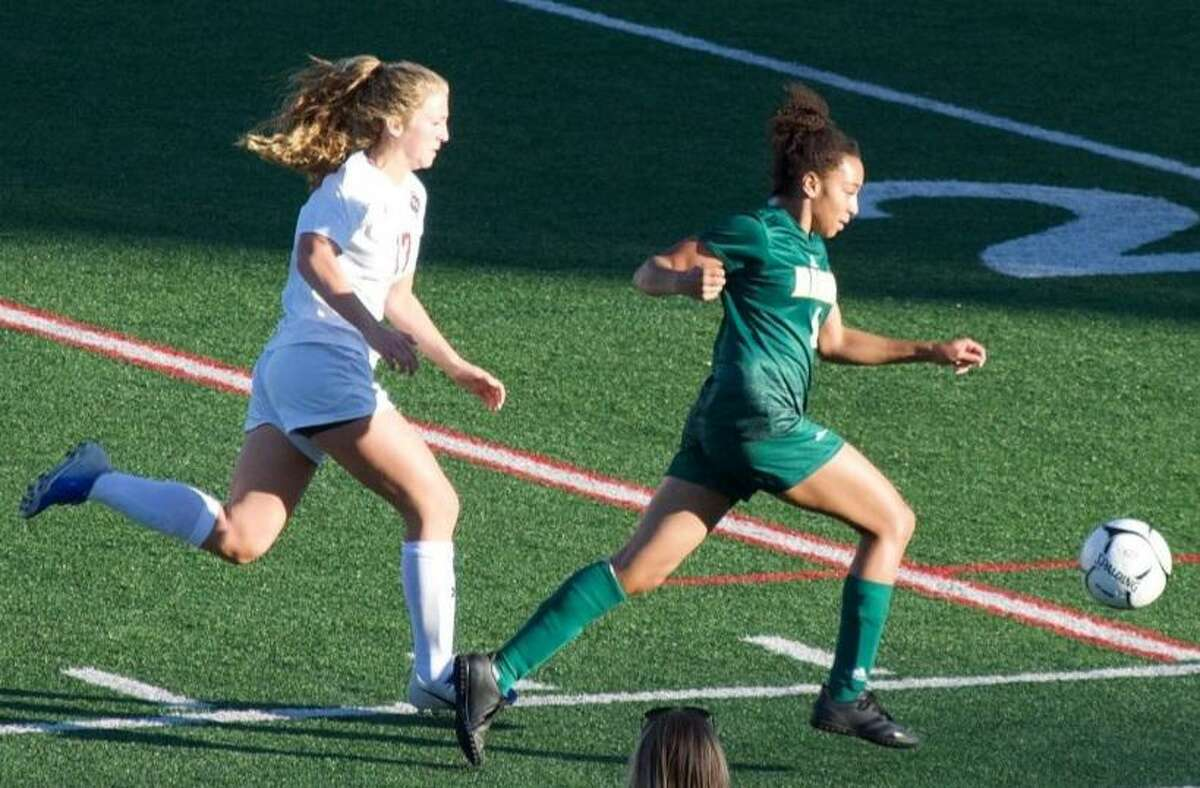 Hamden's Ari Mullin (right)_ recorded her second hat trick of the season in the win over Sacred Heart Academy last week.