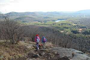 Outdoors writer Gillian Scott and her daughter descend Potash Mountain in the Lake George Wild Forest. (Herb Terns / Times Union)