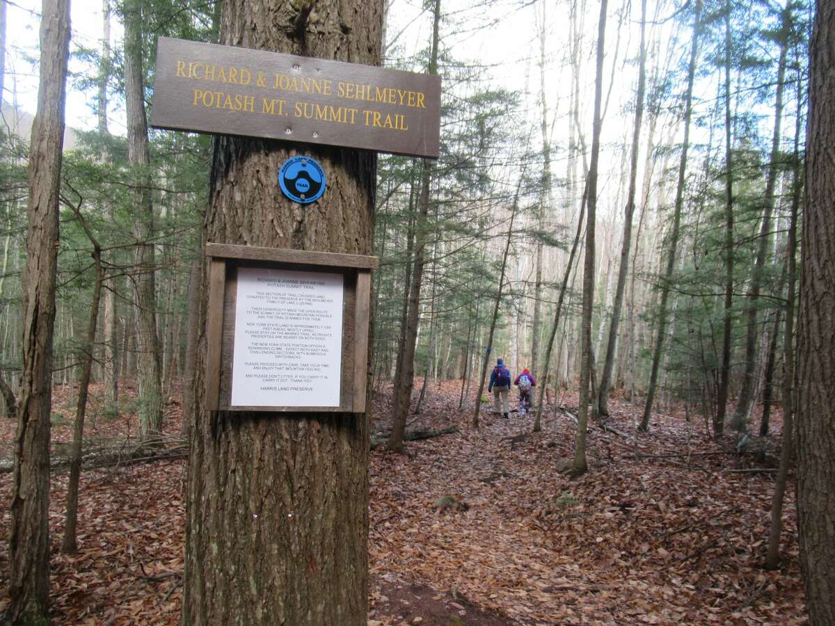 A sign on Potash Mountain marks the area where local landowners donated land for a trail to connect the Harris Land Preserve to state land on the mountain's summit. (Herb Terns / Times Union)