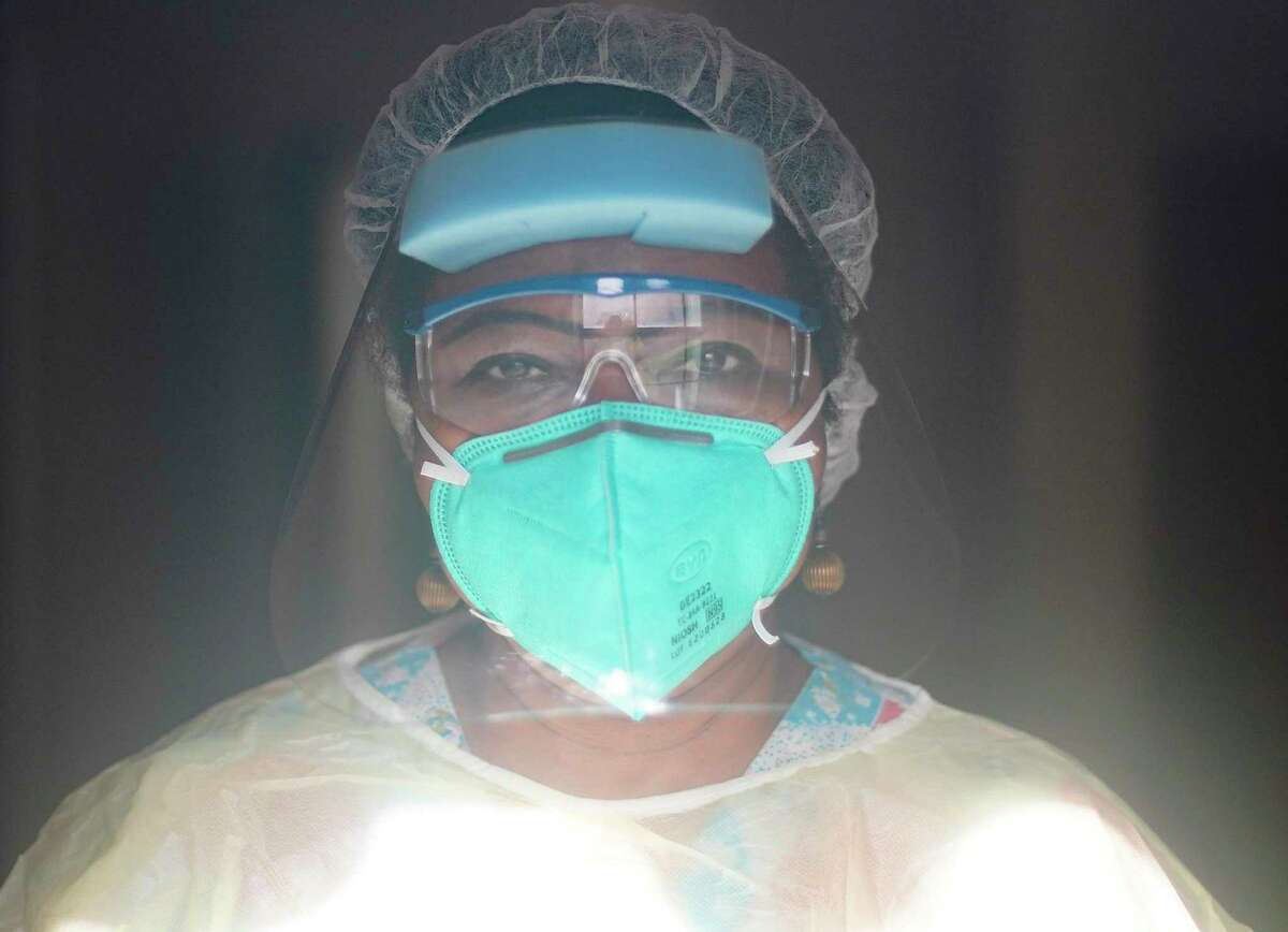 Grace Emukah, a nurse for Focus Care of Westwood, poses for a photo in a room in Houston on Tuesday, Nov. 17, 2020.