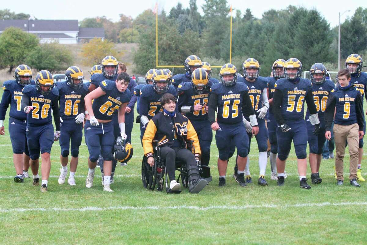 Manistee senior Keelan Eskridge leads the Chippewas to the victory bell after a win this season. (Dylan Savela/News Advocate)