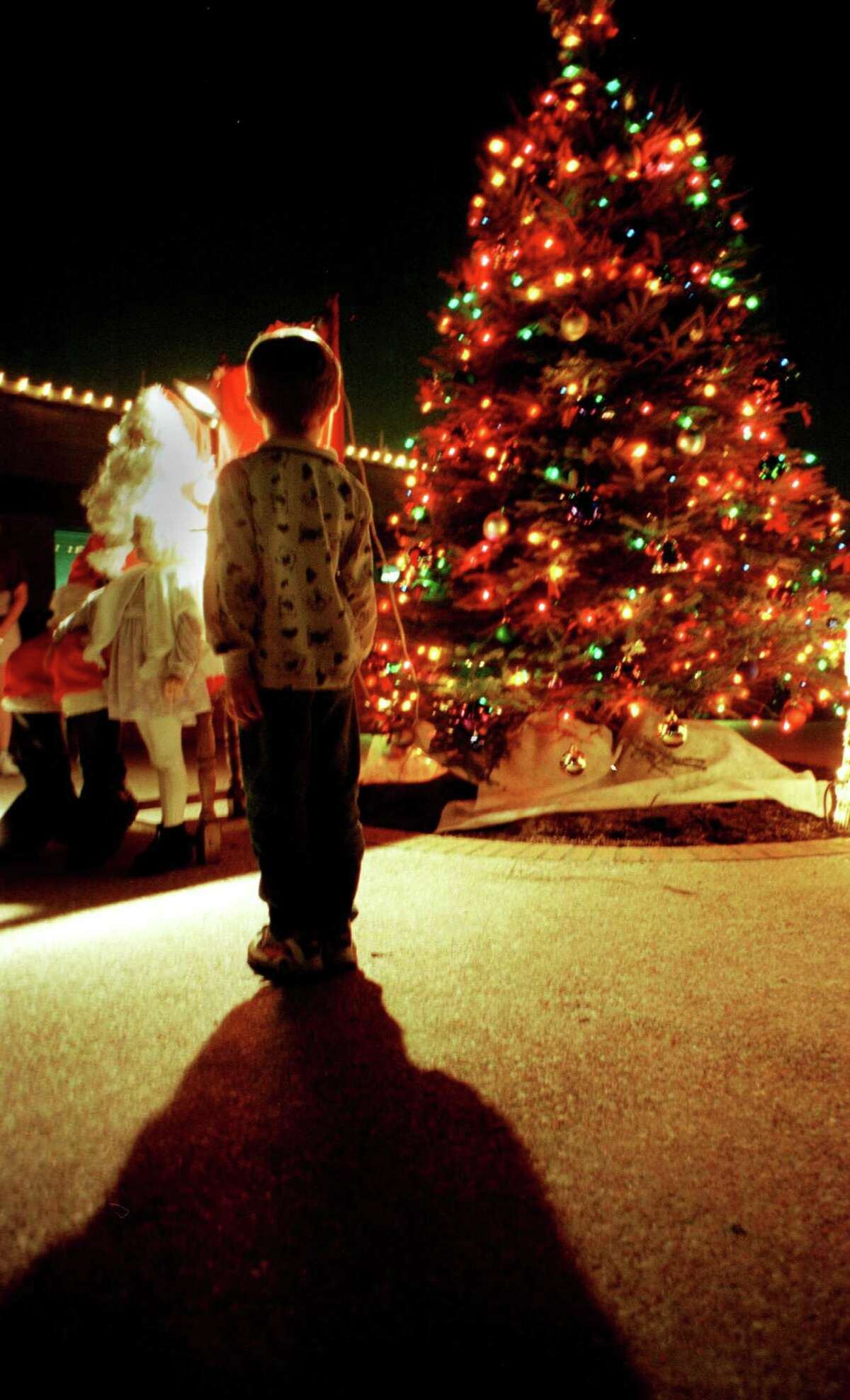 A young boy waits his turn to talk to Santa after the West University Place tree lighting ceremony Monday Dec. 3,2001 at the West University City Hall. (Dave Rossman/Special to the Chronicle) HOUCHRON CAPTION (12/06/2001)