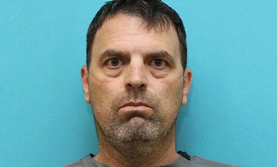 "Carrollton detectives say that Keith Ashley, 48, staged the fatal shooting of 62-year-old James ""Jim"" Seegan of Carrollton to make it appear as though it was suicide. Photo: Carrollton Police Department"