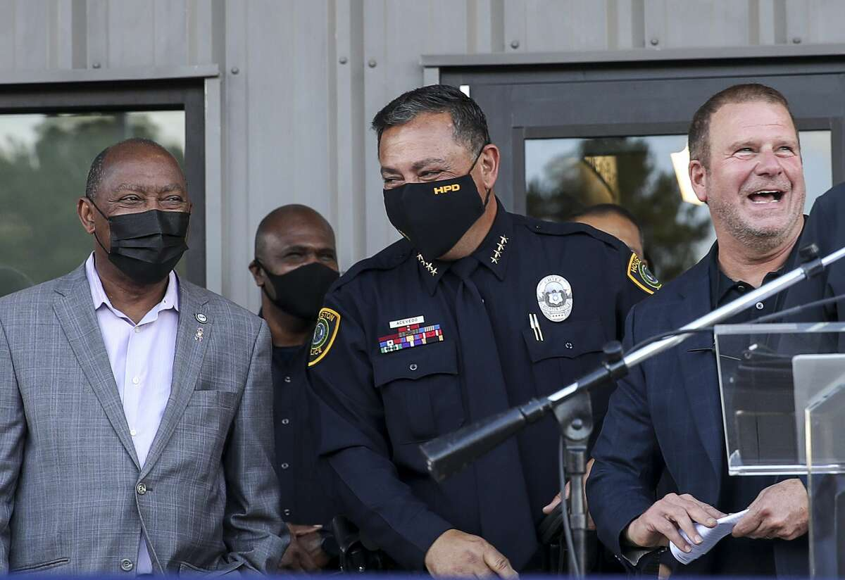 Houston Mayor Sylvester Turner, from left, Houston Police Chief Art Acevedo and Tilman Fertitta share a light moment during a ceremony to unveil a new HPD training center Thursday, Nov. 19, 2020, at the Tilman Fertitta Family Tactical Training Center in Houston.