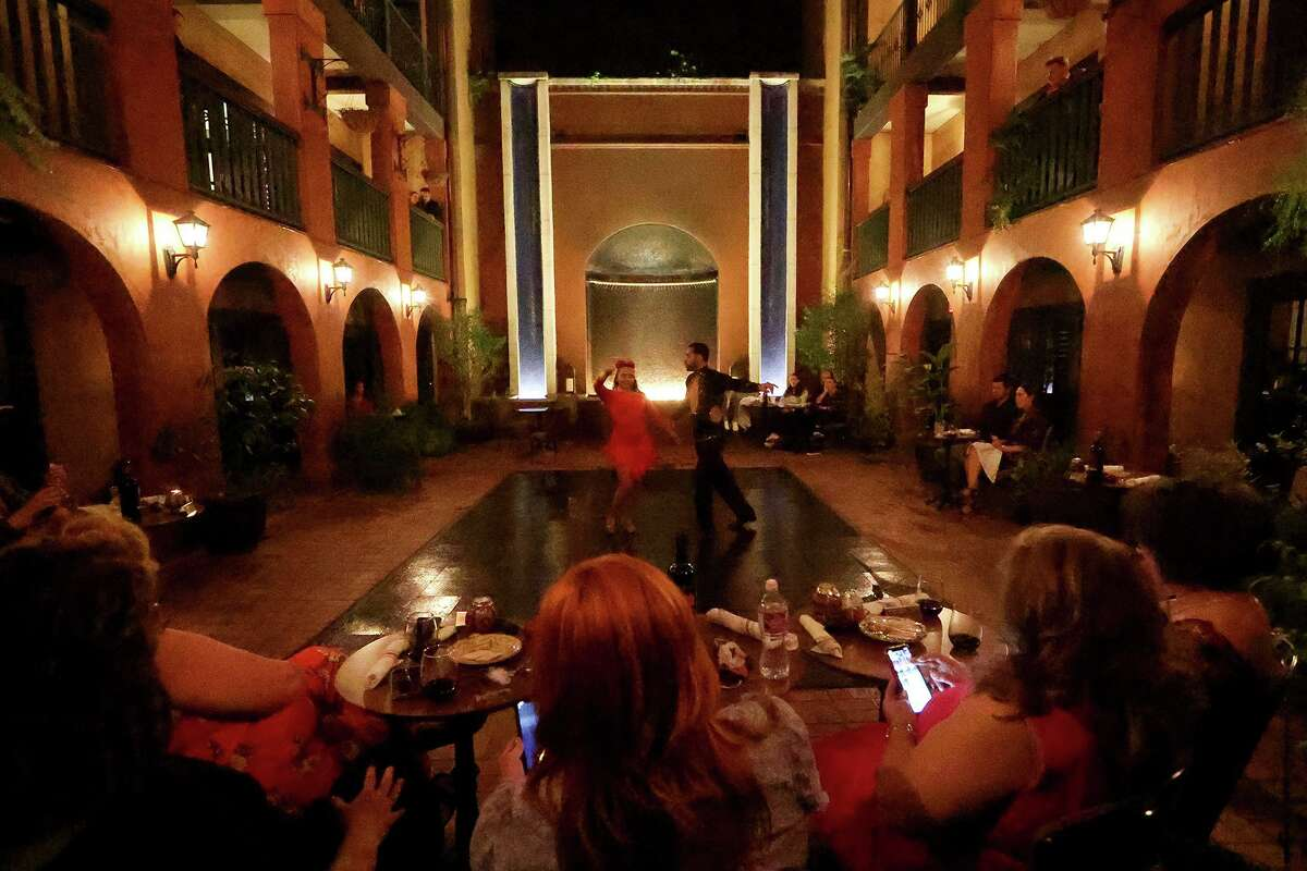 Guests at the Hotel Valencia Riverwalk enjoy a tango performance in the courtyard last month. Since the performances began, occupancy on the weekends as been as high as to 80 percent, the general manager says.
