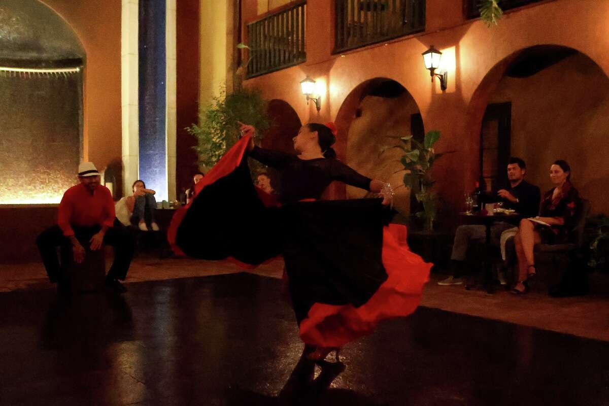 Guests at the Hotel Valencia Riverwalk enjoy a weekend Tengo performance by Luisa Vasquez and Julio Ossorio Torres in the courtyard on Saturday, Oct. 17, 2020.
