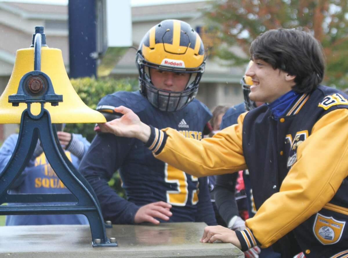 Manistee senior Keelan Eskridge rings the Chippewas' victory bell after a win this fall. Eskridge suffered a season-ending injury during his team's season opener, but remained captain from the sidelines.