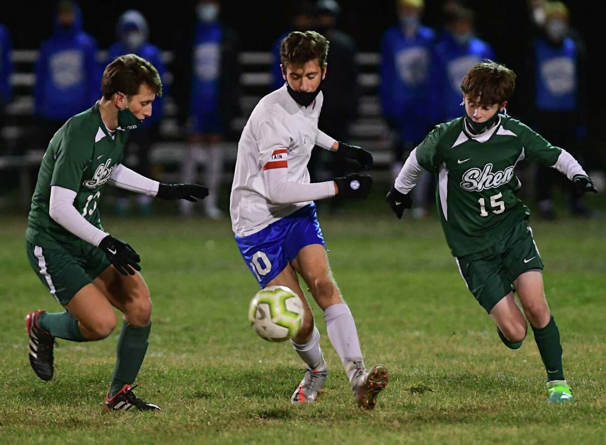 Shenendehowa's Michael Yate, left, and Ben Tymeson, right, double team Saratoga's Jack Donnelly during a Suburban Council semifinal soccer game on Thursday, Nov. 19, 2020 in Clifton Park, N.Y. (Lori Van Buren/Times Union)