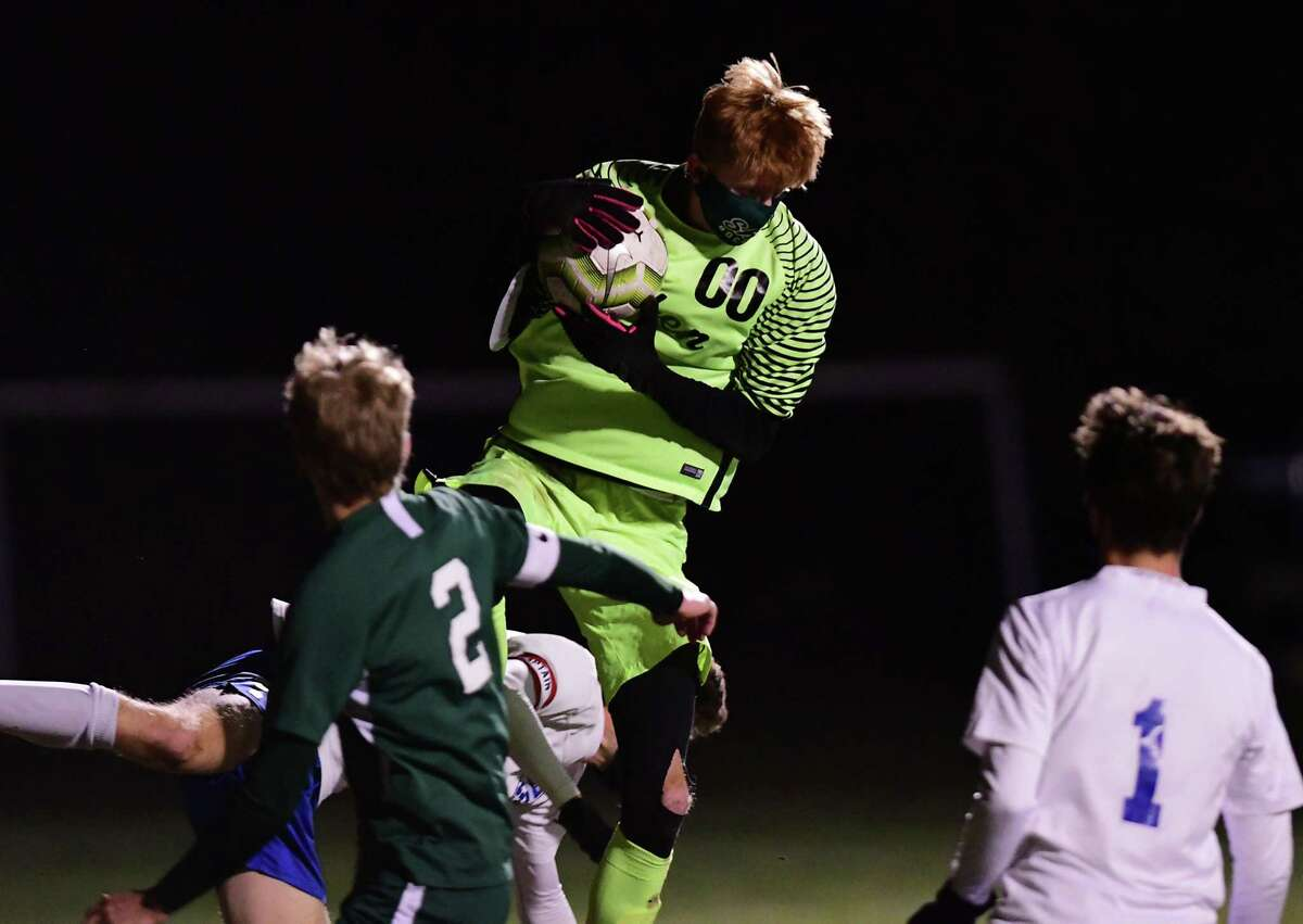 Saratoga goalie Tyler Munter leaps in the air to make a save on a corner kick attempt during a Suburban Council semifinal soccer game against Shenendehowa on Thursday, Nov. 19, 2020 in Clifton Park, N.Y. (Lori Van Buren/Times Union)