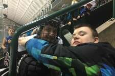 Josh Kosack of Union hockey interacts with a young fan at Dartmouth. The interaction helped inspire Kosack to start Kozi's Kids, which introduced kids to college hockey. (Courtest of Union College Athletics)